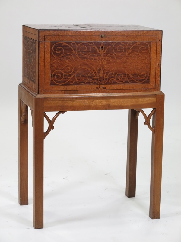 An English Marquetry Box Desk on an Oriental style stand, 19th Century. Few loses to the marquetry