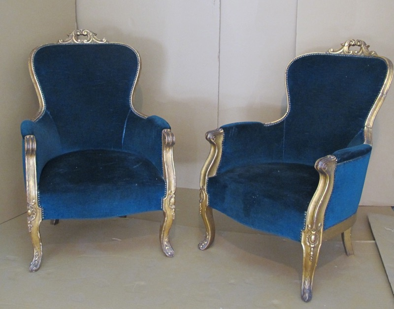 "A pair of giltwood ""bergere"" armchairs with blue velvet