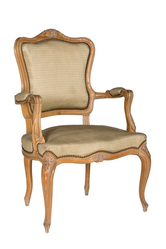 A carved wooden armchair, Louis XV Style