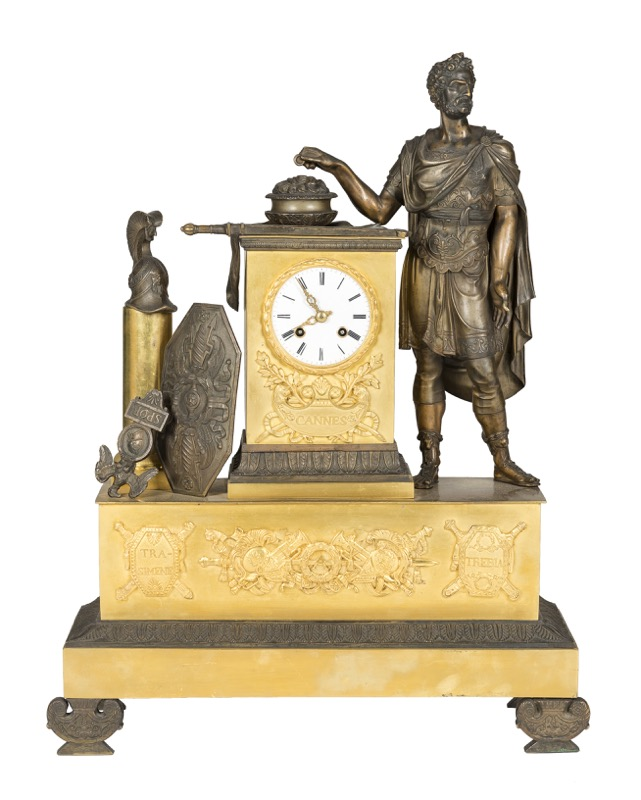 A French patinated and gilded bronze mantel clock topped by the figure of Hannibal as an allegory of the Battle of Cannae, Empire period, Early 19th Century