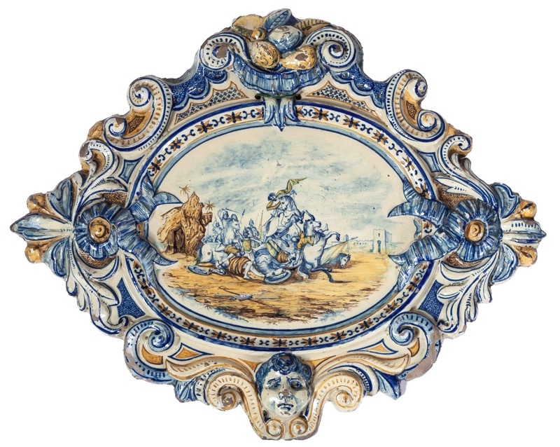 An Italian glazed ceramic plate with battle scene, 19th Century
