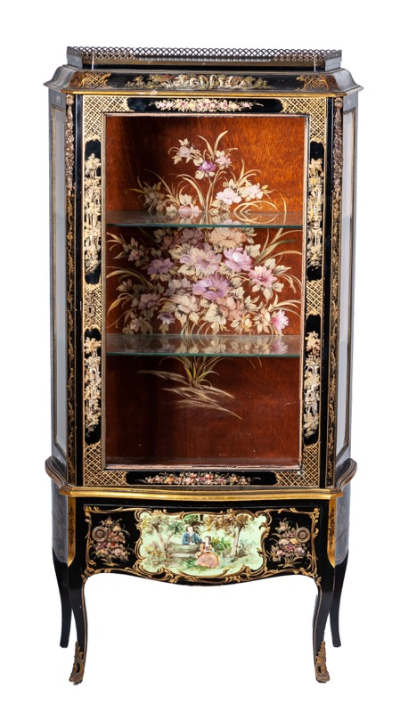 A gilded and black lacquered showcase in Louis XV style