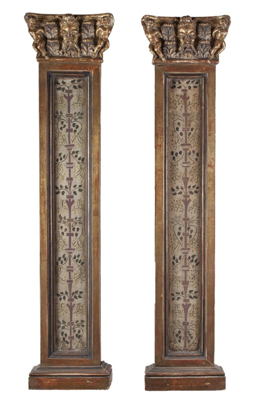 A pair of carved, polychrome and partly gilded pilasters following models of the 16th Century