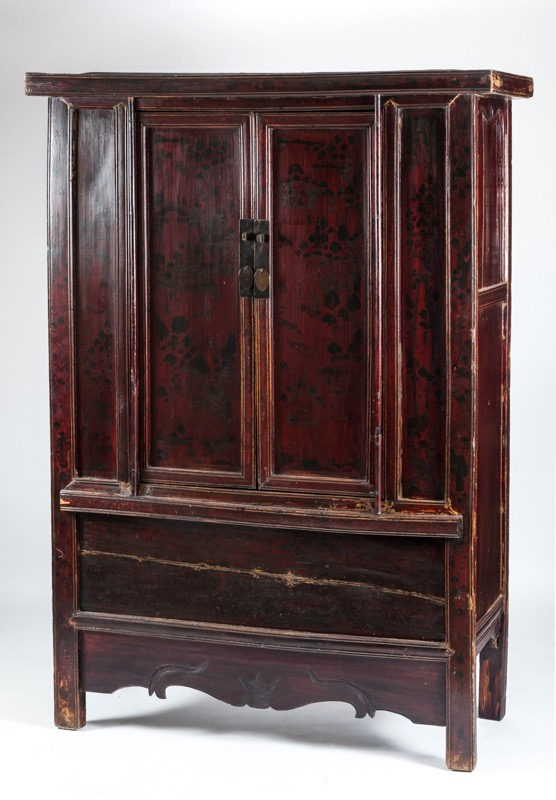 A Chinese carved and polychromed wood wardrobe