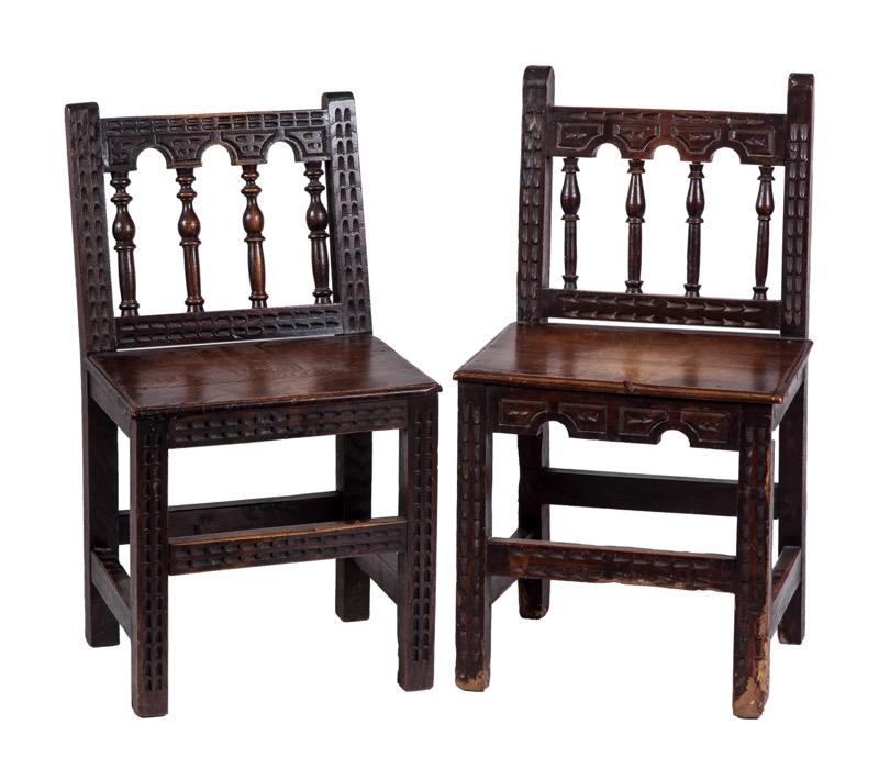 A pair of Spanish popular chairs with carved and turned back, North Spain work of the 19th Century