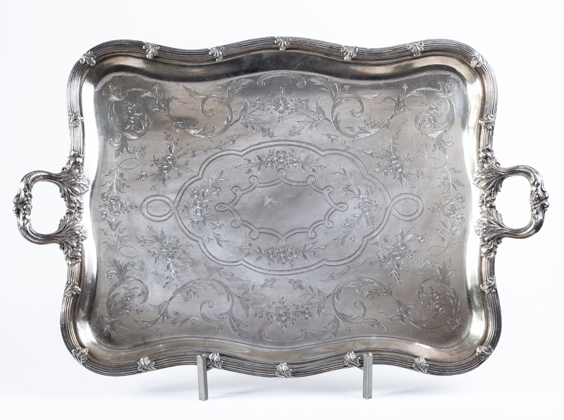 A silver plated tray with handles