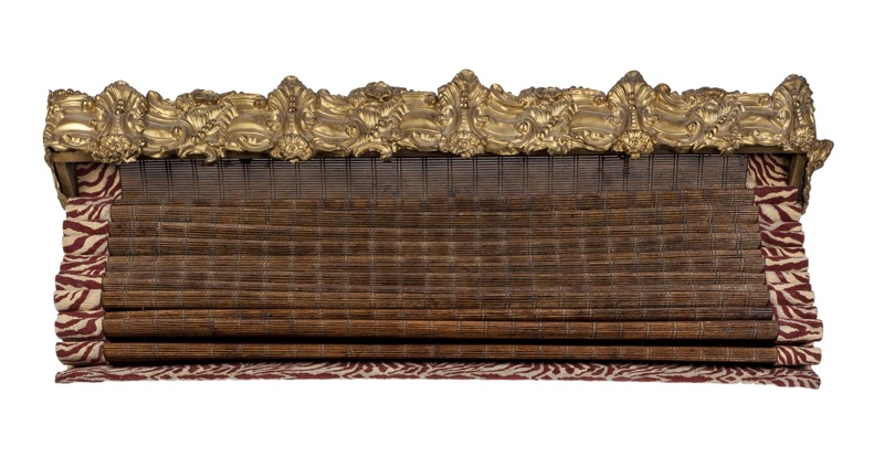 An embossed gilded metal pelmet, Late 19th Century