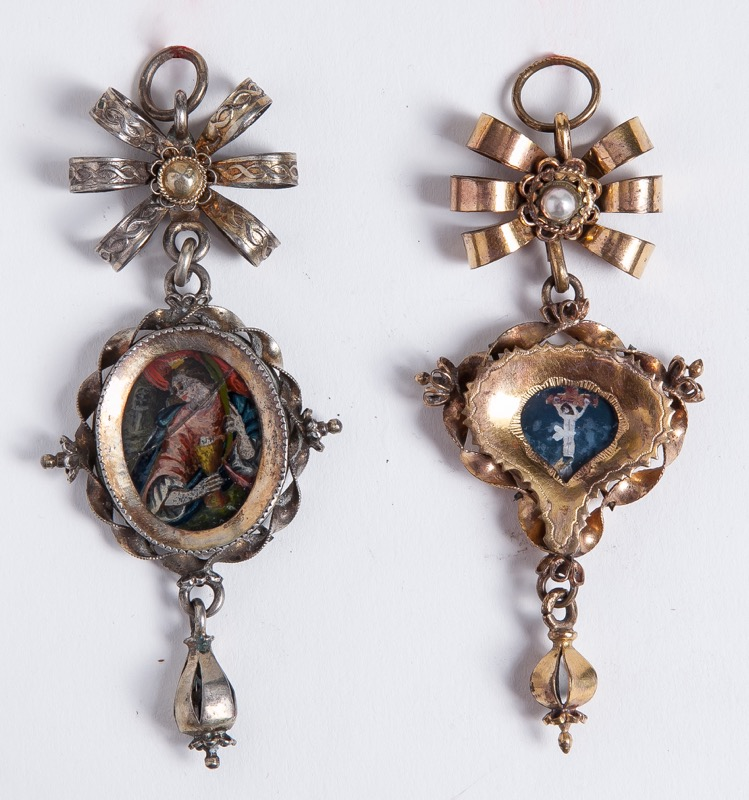 A silver-gilt pendant reliquary with reverse glass paintings, 18th Century