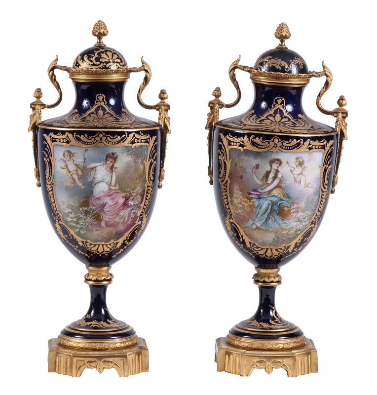 "A pair of ormolu-mounted Sèvres porcelain blue-ground vases with galant scenes within cartouches in Louis XVI style, 19th Century, Signed ""Lhégi"" 