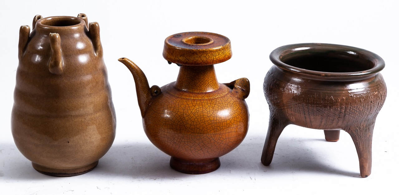 A set of three Oriental glazed ceramic vessels