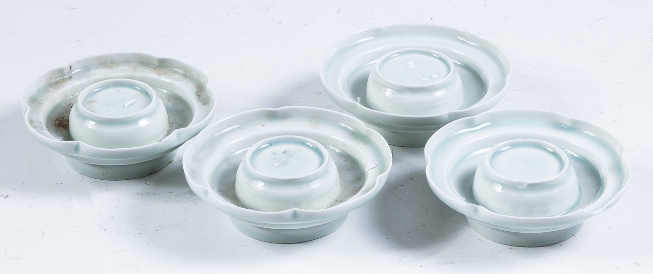 A set of four Oriental lotus-shaped porcelain vessels