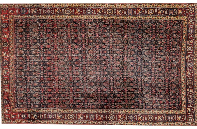 A Persian Korashan rug with floral pattern, 19th Century