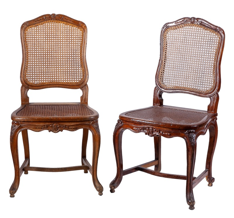 A pair of French caned chairs in Louis XV style