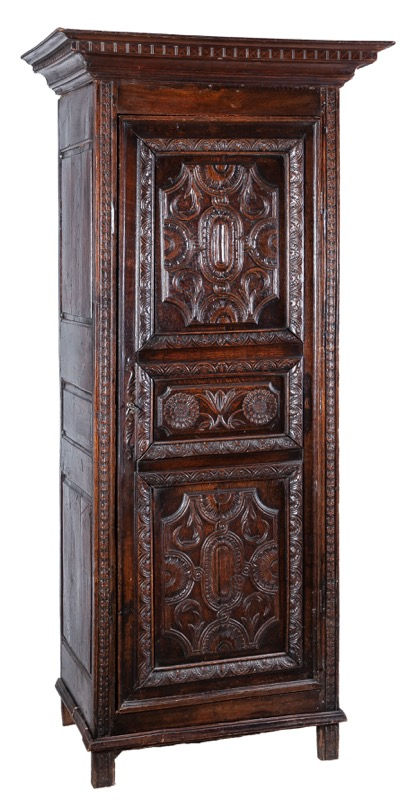 "A French oak ""bonneterie"" cabinet with carved decoration, 18th Century