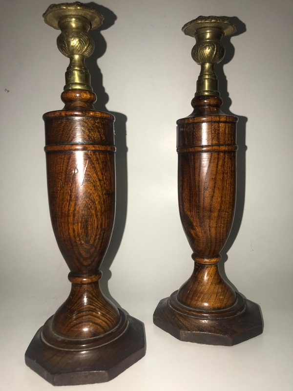 A pair of English wood and brass candlesticks, 19th Century
