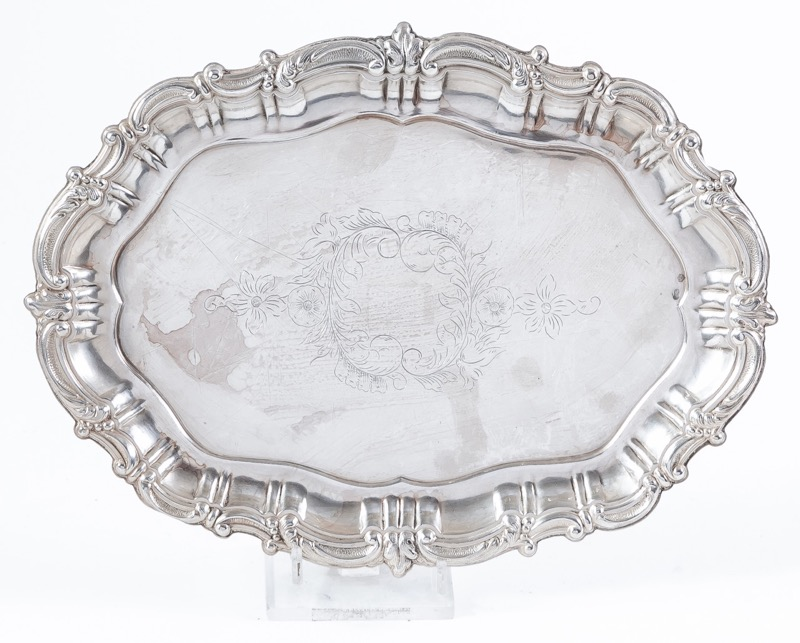 A small engraved silver tray 