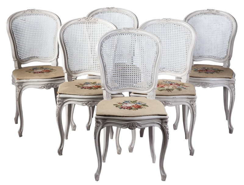 A set of six white lacquered caned chairs in Louis XV style