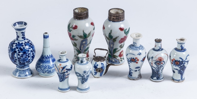 A set of nine Chinese porcelain snuff bottles and one miniature tea pot, 18th - 19th Century