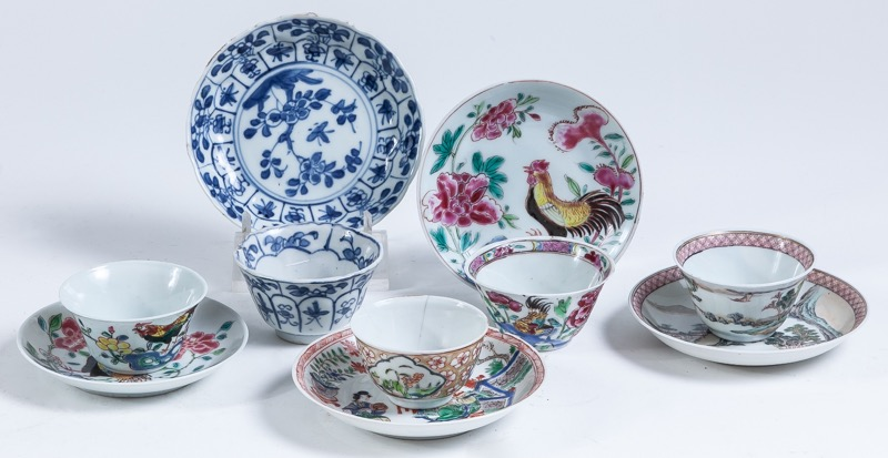 A set of five Oriental porcelain cups and saucers, 19th Century