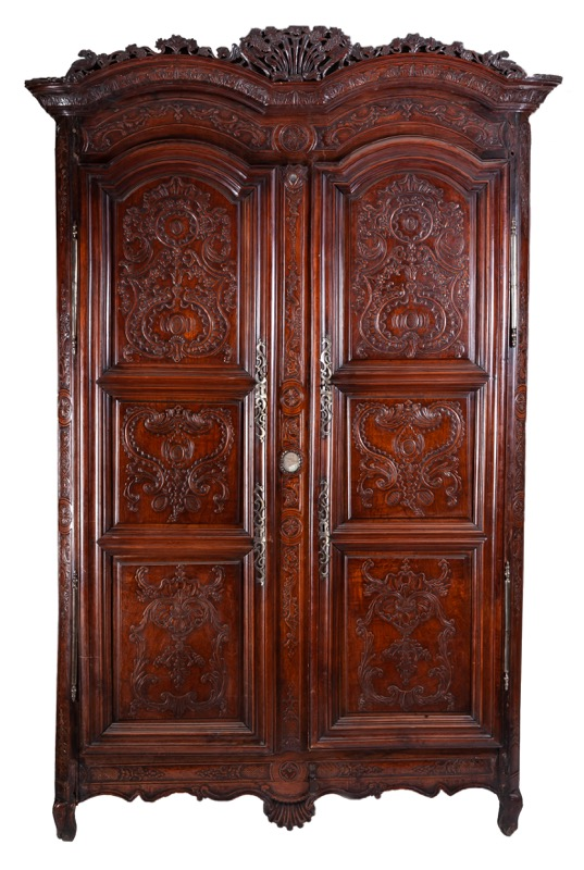 A Breton carved cherrywood and walnut two door wardrobe, attributed to Julien Dondel, Rennes Second half of the 18th Century