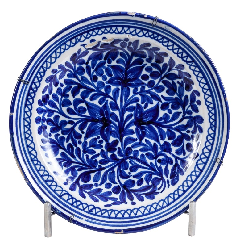 A Spanish Levantine blue and white glazed ceramic dish, Late 19th Century