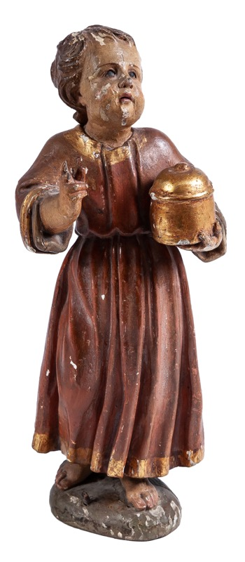 A carved and polychrome-decorated wooden sculpture of a child with a vessel, 17th Century