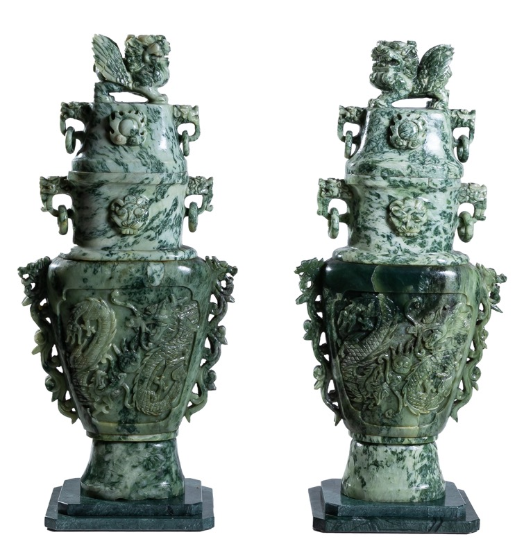 A pair of Chinese carved jade vases topped with lions, mid. 20th Century