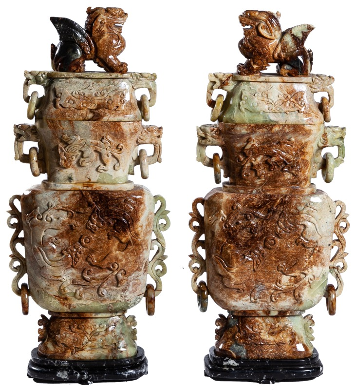 A pair of Chinese jade vases decorated with dragons and topped with lions
