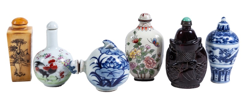 A set of six Chinese snuff bottles made of porcelain, bone, ox horn and enamel