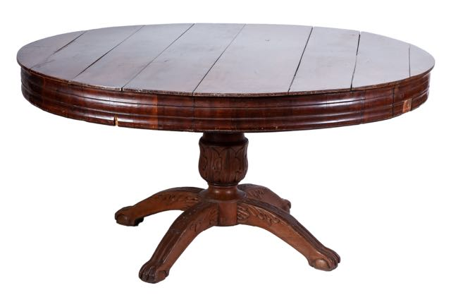 A circular mahogany centre table