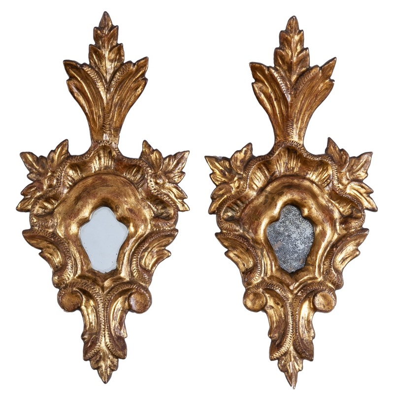 A pair of small carved giltwood mirrors, 18th Century