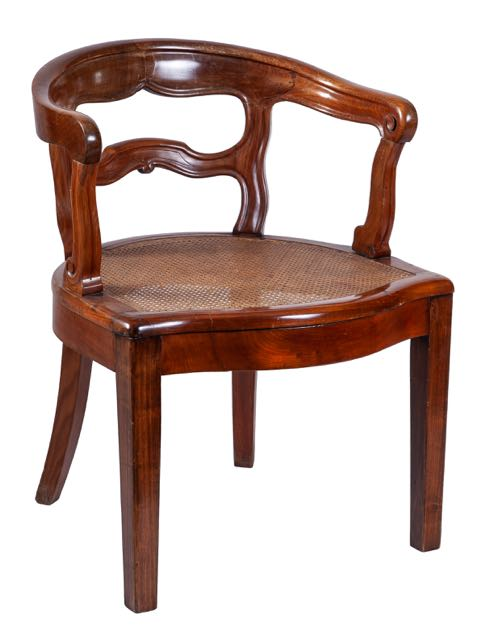 A mahogany caned desk chair