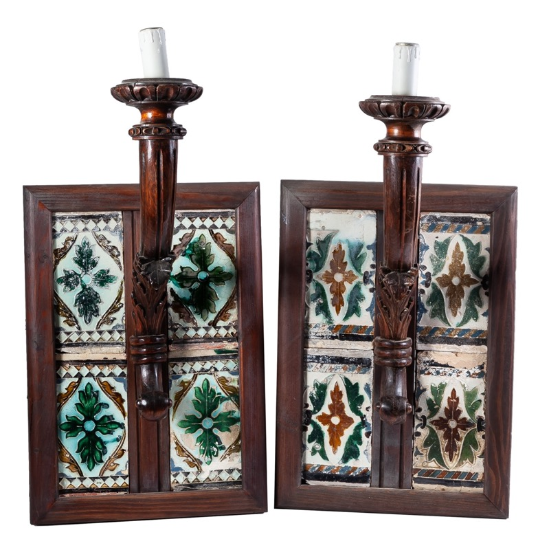 A pair of carved wood and azulejos wall lamps