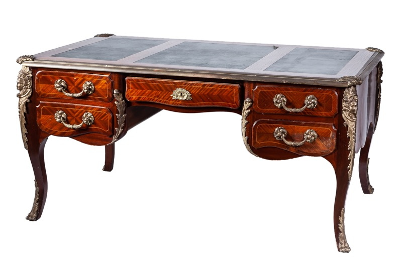 A gilt-bronze mounted leather-topped mahogany bureau plat in Louis XV style