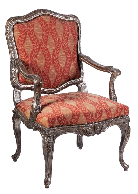 An Italian carved silver wood armchair following models of the 18th Century
