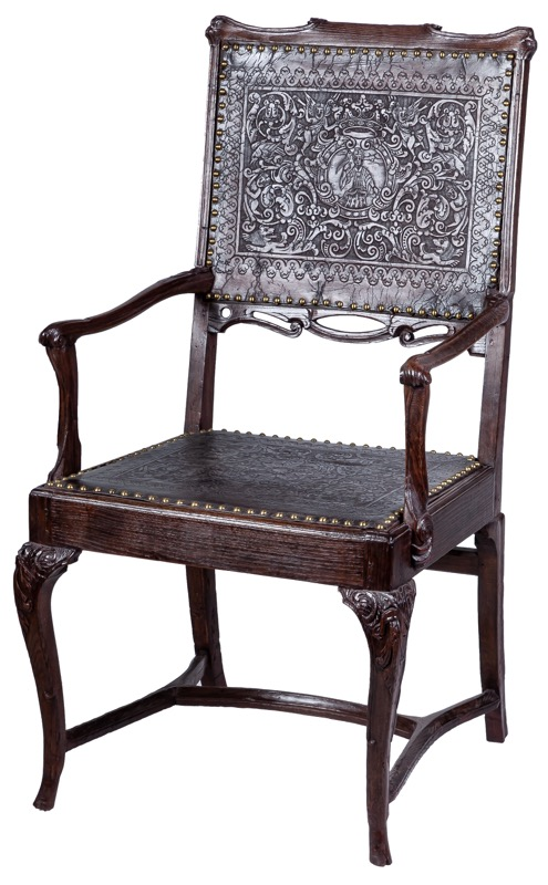 A Portuguese embossed leather and chestnut wood armchair, 18th Century