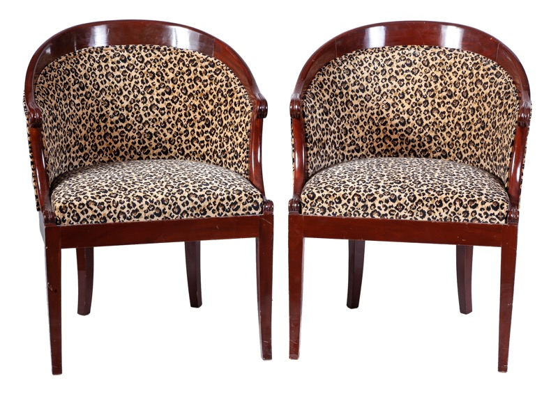 "A pair of upholstered mahogany ""gondole"" chairs in Empire style