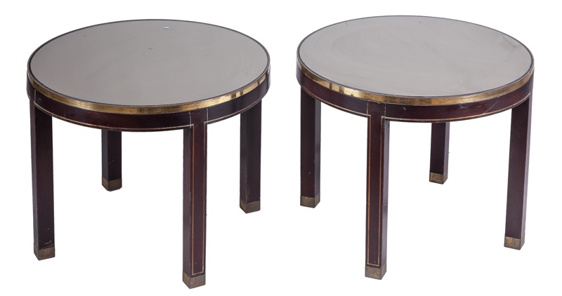 A pair of mirror-topped bronze and wood side tables