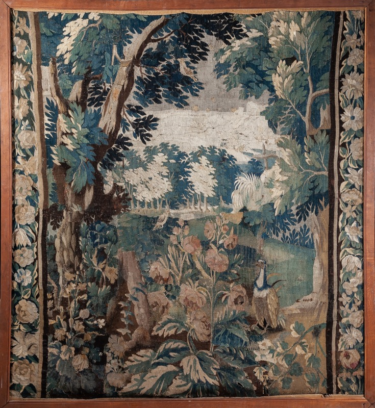 A framed woolen verdure tapestry 