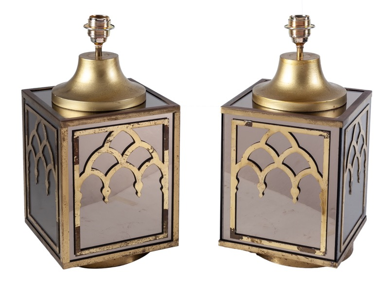 A pair of brass and smoked mirror table lamps