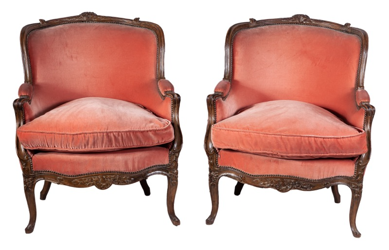 A pair of salmon velvet upholstered walnut bergeres in Louis XV style, 1970s