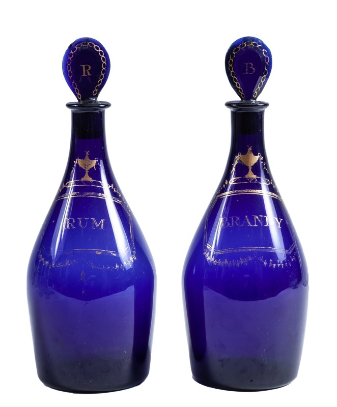 A pair of English gild-decorated blue glass decanters, Bristol 18th century