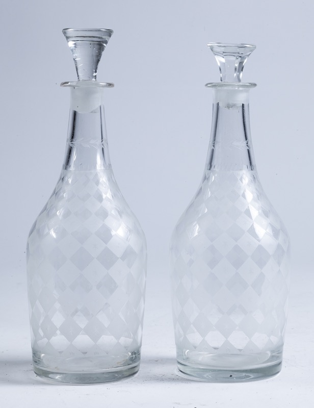 A pair of engraved glass decanters