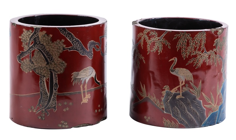 A pair of cylindric red-lacquered papier mache pots