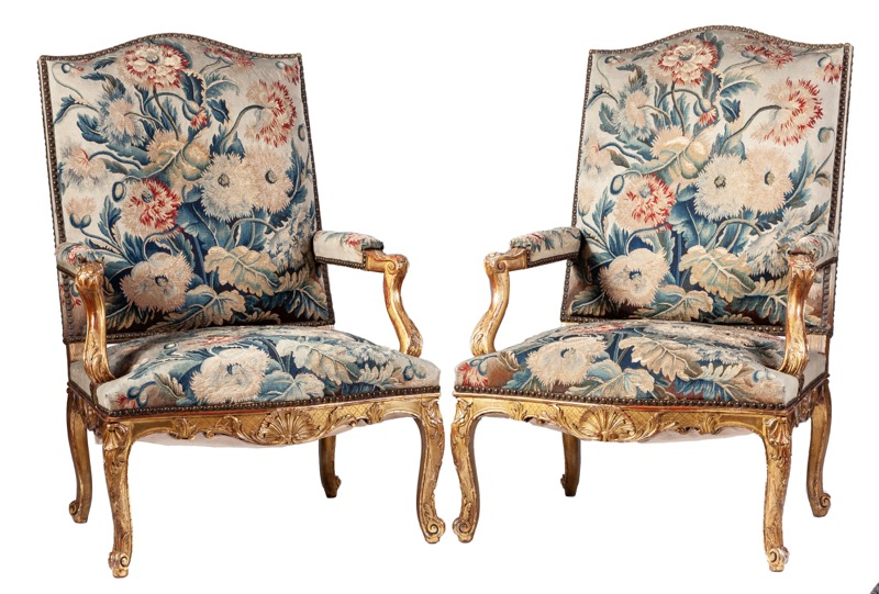A pair of Régence style tapestry upholstered giltwood armchairs, 19th Century
