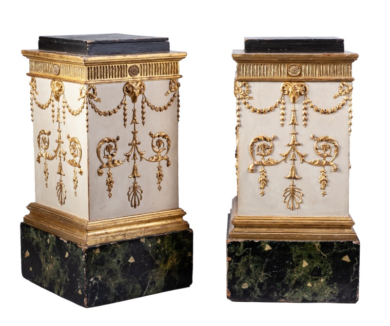A pair of English carved, painted and partly gilded pedestals, George III period. Probably after designs of Robert Adam 