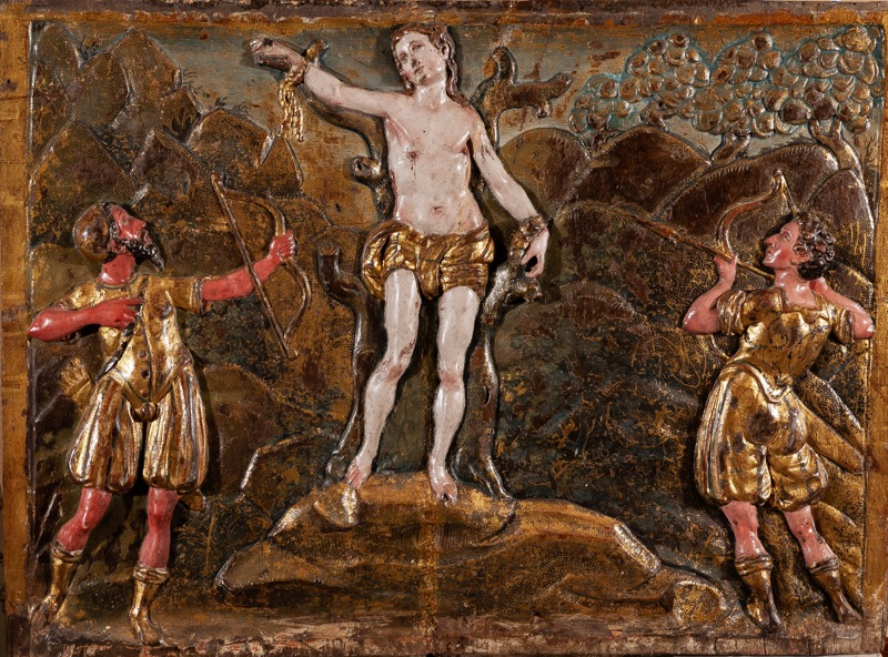 "A carved, polychrome-decorated and gilded wooden panel represneting ""The Martyrdom of Saint Sebastian"", Castille Late 16th Century