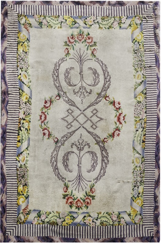 A Spanish woolen rug in Charles IV of Spain style