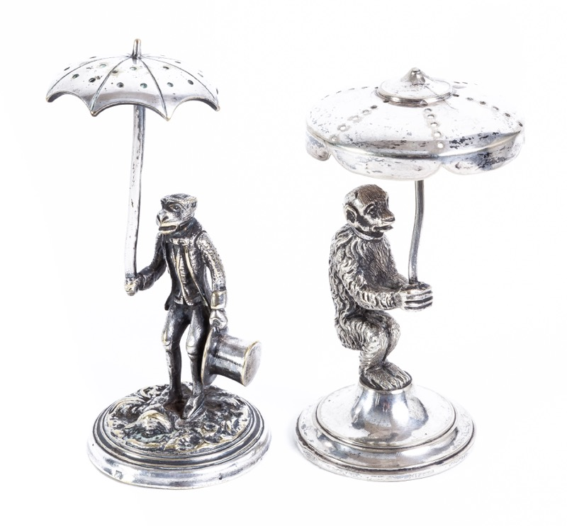 Two silver plated figural stick holders