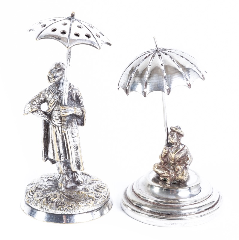 Two figural stick holders 